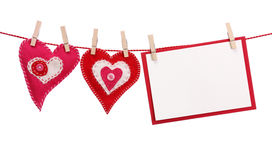 Two hearts and blank card Stock Images