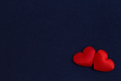 Two hearts on a blue velvet Royalty Free Stock Photo