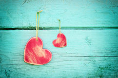 Two hearts on a blue wooden background Stock Image