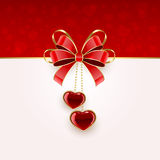 Two hearts and bow Royalty Free Stock Photos