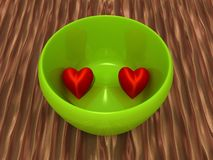 Two hearts in a bowl Royalty Free Stock Image