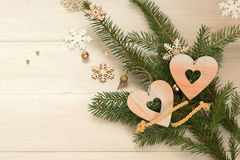 Two hearts with branches of a Christmas tree. Stock Photo