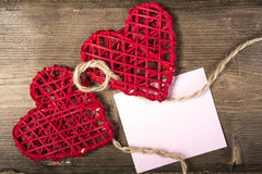 Two Hearts on burlap Background. Wedding Love Concept. Two Hearts linked by rope on burlap Background.with blank memo, Wedding Love Concept Stock Photos