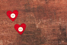 Two hearts and buttons on wooden background Royalty Free Stock Images