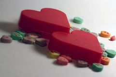 Two Hearts with candy royalty free stock photo