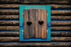 Two Hearts Carved in Window Shutters stock image