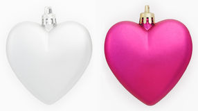 Two hearts Christmas decorations isolated on white. Gray and pink royalty free stock image