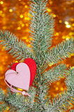 Two hearts on christmas fir tree branch Royalty Free Stock Image