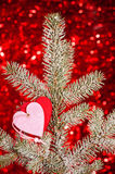 Two hearts on christmas tree branch Royalty Free Stock Image