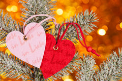 Two hearts on christmas tree branch Royalty Free Stock Photo