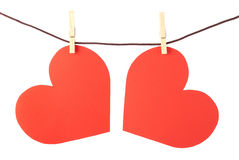Two hearts on the clothesline. Isolated. Val. Two hearts on the clothesline. Isolated on white background. Valentine's Day Stock Images