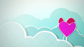 Two Hearts In Clouds Loop. Dynamic graphic animation using paper cutout styled elements to illustrate two hearts floating in the clouds. High definition 1080p stock video footage