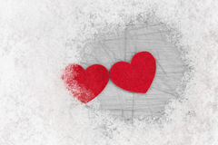 Two hearts among cold snow Royalty Free Stock Photos