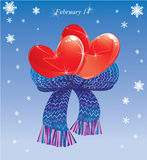 Two hearts conjuncted of warm scarf. Stock Image