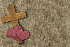 Two hearts and cross on old canvas Stock Photography