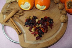 Two hearts cut oranges and fruit and spices Royalty Free Stock Photos