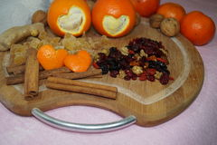 Two hearts cut oranges and fruit and spices Stock Photos