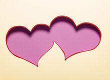 Two hearts cutout in paper. Royalty Free Stock Image