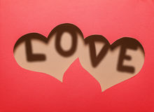 Two hearts cutout in red paper with word Royalty Free Stock Photography