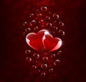 Two hearts on dark red background Royalty Free Stock Photos