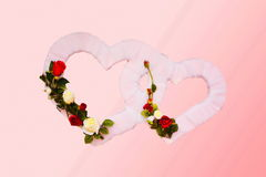 Two hearts decorated with flowers, background. For wedding celebration Stock Images