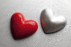 Two hearts dewy water on a metal plate Stock Photo