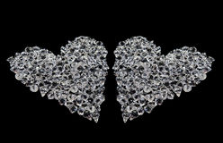 Two hearts of diamonds on black Royalty Free Stock Images