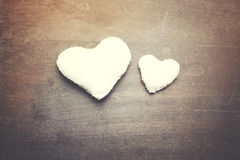 Two hearts. Two different sizes hearts on wooden table Stock Photography