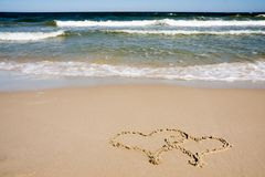 Two hearts drawn on beach Royalty Free Stock Images