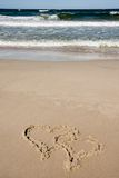 Two hearts drawn on beach Stock Photos
