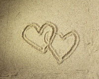 Two hearts drawn in beach Royalty Free Stock Image