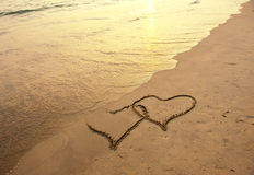 Two hearts drawn in beach Royalty Free Stock Images