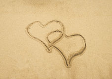 Two hearts drawn in beach Stock Photo