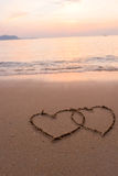 Two hearts drawn in beach Stock Images