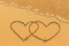 Free Two Hearts Drawn In The Sea Sand With The Soft Wave. Love. Stock Images - 93858904