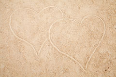 Two hearts drawn in sand Royalty Free Stock Image