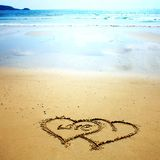 Two hearts drawn in the sand Royalty Free Stock Images