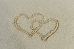 Two hearts drawn in sand Royalty Free Stock Photography