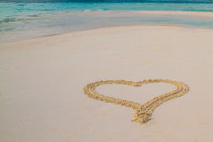 Two hearts drawn in the sand at the tropical beach Stock Image