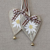 Two hearts with edelweiss royalty free stock images