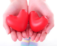 Two hearts in female hands Stock Photography