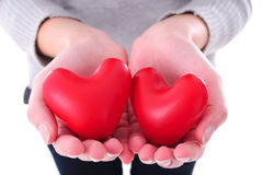 Two hearts in female hands Royalty Free Stock Images