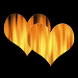 Two hearts in flames. Isolated over black, possible concepts: love, passion, relationship Stock Photography