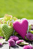 Two hearts. With flowers on wooden background Stock Photo