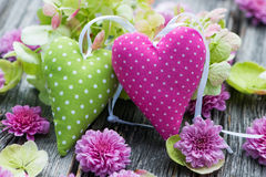 Two hearts. With flowers on wooden background stock image