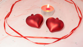 Two hearts fnd candle decoration for Valentine's Day Royalty Free Stock Images