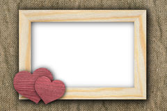 Two hearts and frame on old canvas Royalty Free Stock Photo