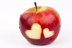 Two hearts on the fresh apple, a Valentines Day theme royalty free stock image
