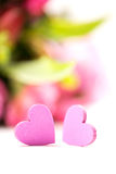 Two hearts in front of flowers Stock Photo