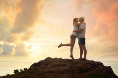 Beautiful young couple embracing and smiling while resting in on Stock Photography